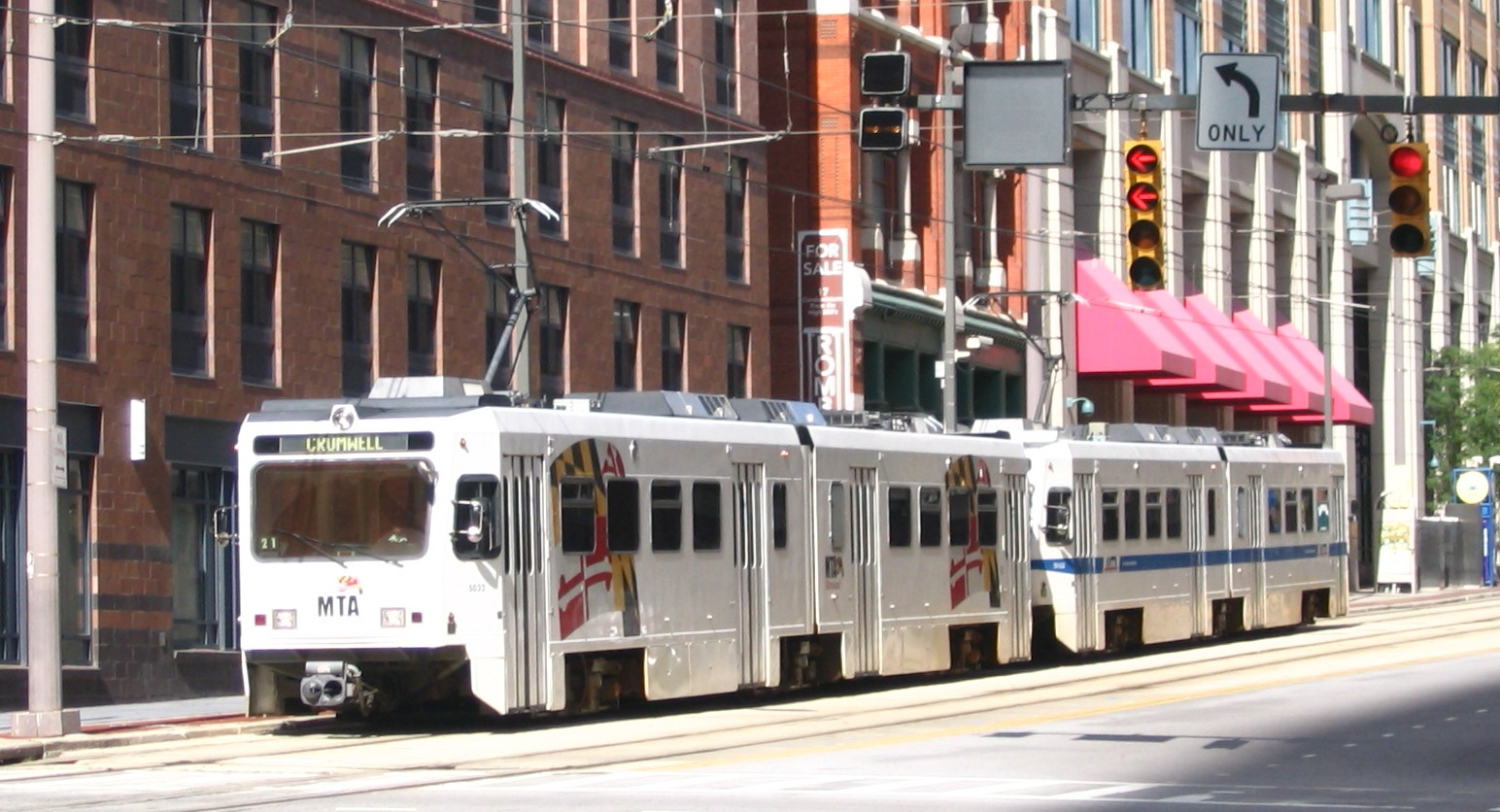 MTA Light Rail Train leaving Baltimore Street Station on a sunny day