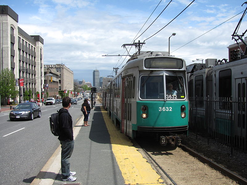People waiting for the Green Line along St. Paul Street