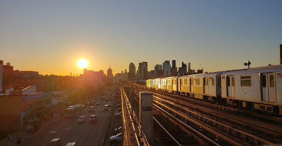 NYC Subway with sunrise in the background