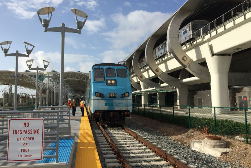 Miami Tri Rail incoming with Metrorail also entering track above