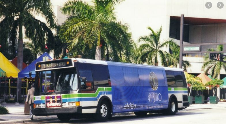 Miami Dade Transit Route 9 bus to Aventura Mall at bus stop with Palm Trees in background