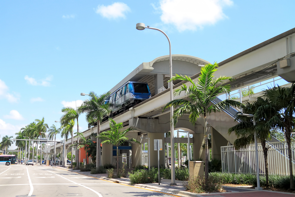 Miami downtown rail system from the road with the city in the background on bright sunny day